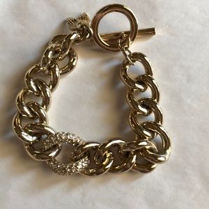 Gold finish link bracelet with pave detail